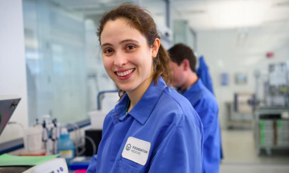 Lab tech smiling