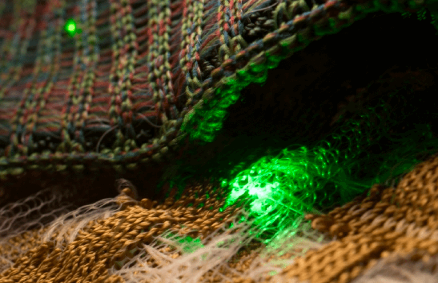 Thread and needle with a green light